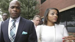 Adrian Peterson arrives at the courthouse with his wife Ashley Brown Peterson, 4 Nov