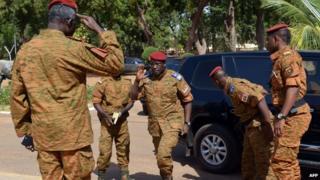 Lt Col Isaac Zida (centre) in Ouagadougou. Photo: 4 November 2014