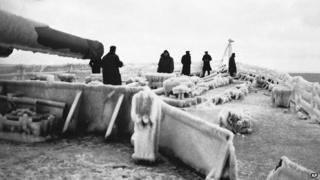 British warship covered in ice during an Arctic Convoy