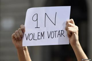 A Student holds a sign saying, 'November 9, we want to vote' during a protest in October, 2014