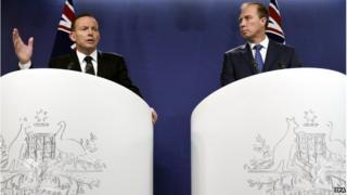 Australian Prime Minister Tony Abbott (L), and Australian Health Minister Peter Dutton (R) during a press conference in Sydney, Australia, 5 November 2014.