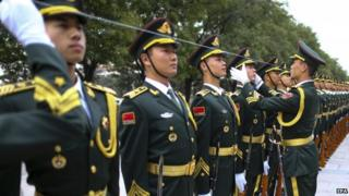 Papers say China military might is aimed keeping the world peaceful