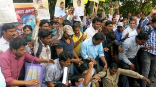 Protesters in Calcutta hold up the certificates issued by a number of bogus companies
