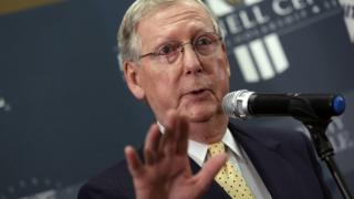 Senate Minority Leader Mitch McConnell speaks at a press conference.