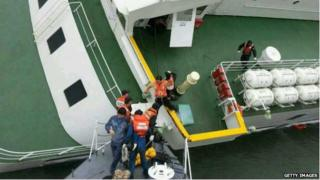 In this handout image provided by the Republic of Korea Coast Guard, passengers are rescued by the Republic of Korea Coast Guard from a ferry sinking off the coast of Jindo Island on 16 April 2014 in Jindo-gun, South Korea.