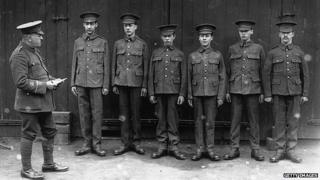 Circa 1915: New recruits line up for inspection in Bermondsey, London during World War One