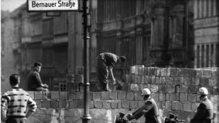 Going Up: a file picture of workers building the Berlin Wall in 1961