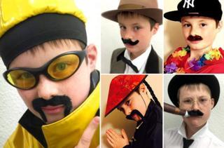 William Heath dressed as moustachioed celebrities