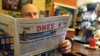 A man reads Czech newspaper Mlada Fronta Dnes with a front page focused on financial crisis 7 Oct, 2008 in Prague