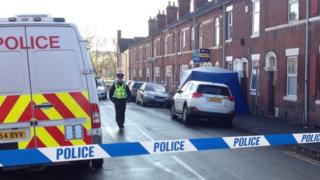 Police and tent outside dead woman's home