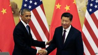 Barack Obama (L) and Xi Jinping have announced new targets on greenhouse gas emissions