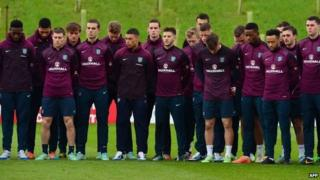 The England football squad observe a two-minute silence while training