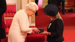 The Queen presents Jane Sutton with Stephen's MBE