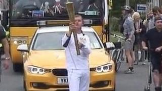 Benjamin Ridd carrying the torch