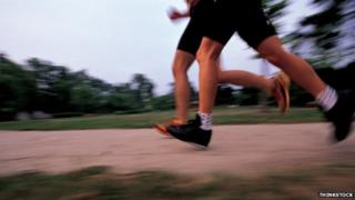 two sets of legs jogging