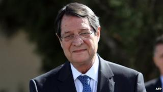 Nicos Anastasiades arrives for a meeting with Turkish Cypriot leader Dervis Eroglu in February 2014.