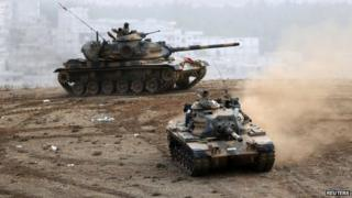Turkish tanks manoeuvre near the Syrian border town of Kobane where Kurds are fighting Islamic State (11 Oct)