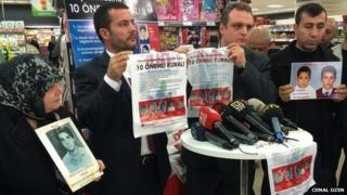Two men present the plastic bags during a media briefing