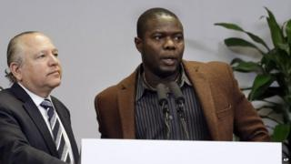 Josephus Weeks, nephew of Thomas Eric Duncan, speaks as attorney Les Weisbrod looks on during a news conference in Dallas, Wednesday, 12 November 2014