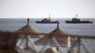 Egyptian navy vessels patrol off the coast of the Red Sea resort city of Sharm el-Sheikh on 17 February 2011.