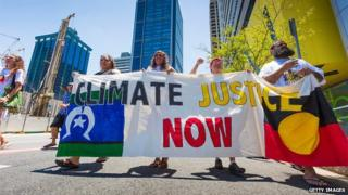 Demonstrators protest in the Brisbane CBD over climate change, uranium mining, coal seam gas fracking and traditional land rights ahead of the 2014 G20 Leaders Summit