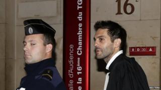 Pierre Darkanian (R), lawyer of Flavien Moreau, a 27-year-old described in court documents as a determined Islamist militant, leaves a Paris court, 13 November 2014
