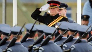 Prince Harry salutes parading soldiers