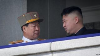 A photo taken on April 15, 2012 shows a man believed to be Choe Ryong-Hae (L) talking with North Korean leader Kim Jong-Un (R) attending a military parade in Pyongyang. North Korea