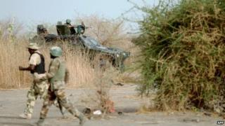 Nigerian soldiers patrol in the north of Borno state - 2013