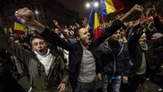 Anti-government supporters celebrate on Sunday night (16 Nov)