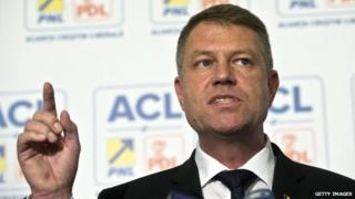 Romanian President-elect Klaus Iohannis addresses a news conference.