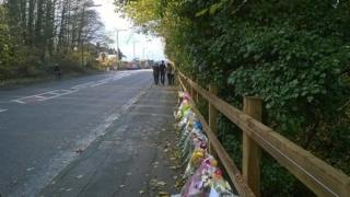 Bunches of flowers at the spot where the teenagers were killed