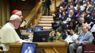 Pope Francis (L) addresses the participants of a seminar in the Vatican on family values on 17 November 2014