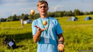 Man juggling onions