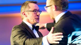 Tommy Gormley receiving outstanding achievement in craft award from Simon Pegg at Bafta Scotland awards