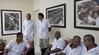 Cuban doctors who will travel to Liberia and Guinea, wait for the start of a press event in Havana, Cuba, Tuesday, Oct. 21, 2014.