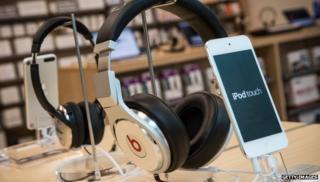 Beats headphones next to ipod touch