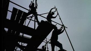 Silhouette of builders on construction site