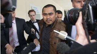 Malaysian diplomate Muhammad Rizalman Ismail, who is charged with attempted rape, is surrounded by journalists outside the Wellington District Court on 28 October 2014