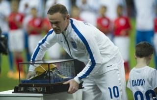 Wayne Rooney receiving his 100th cap