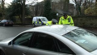 Police stopping motorists at scene