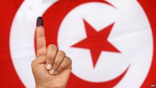 Ink-stained finger of Tunisian voter
