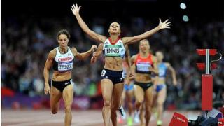 Jessica Ennis celebrates after winning the final event in the 2012 Olympic heptathlon in order to claim the gold medal