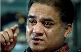 In this 4 Feb 2013 file photo, Ilham Tohti, an outspoken scholar of China's Uighur minority, speaks during an interview at his home in Beijing, China.