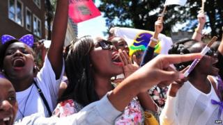 Women rally in protest on 17 November in Kenya's capital, Nairobi, about the stripping of a woman by a mob .