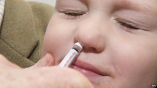 Baby gets nose flu spray