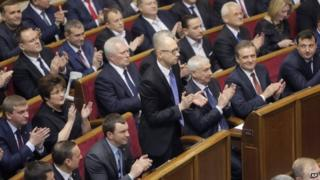 Lawmakers applaud after re-electing Arseny Yatsenyuk as prime minister, 27 November 2014