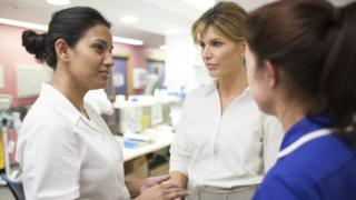 Doctors and nurses talking