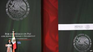 Mexico's President Enrique Pena Nieto delivers a speech during a national broadcasting message from National Palace in Mexico City, Mexico, 27 November 2014