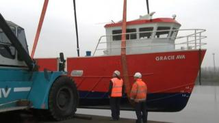 Gracie Ava is lowered into the Tees